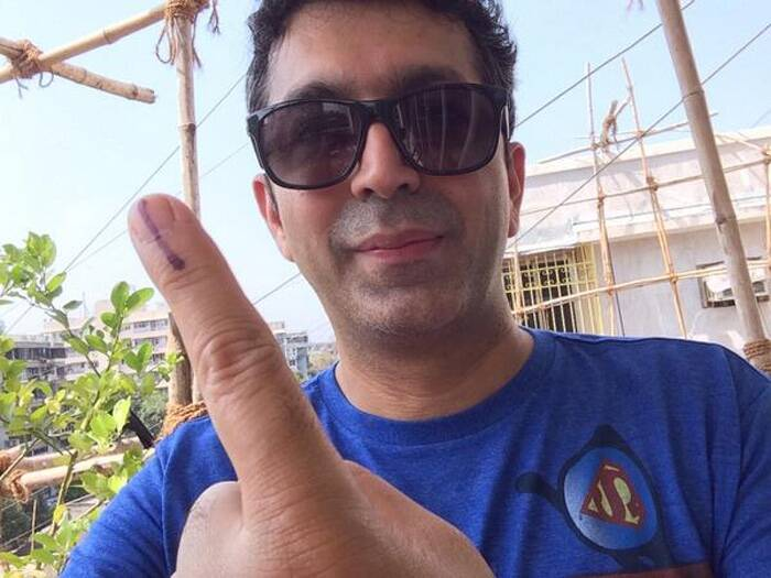 "Filmmaker Kunal Kohli said that earlier he could not find his name on the list at the polling booth, but he soon added, ""I found my name on another list online."" Kunal Kohli prodly tweeted his picture saying, ""Lemme show you my finger!"" (Photo: Twitter)"
