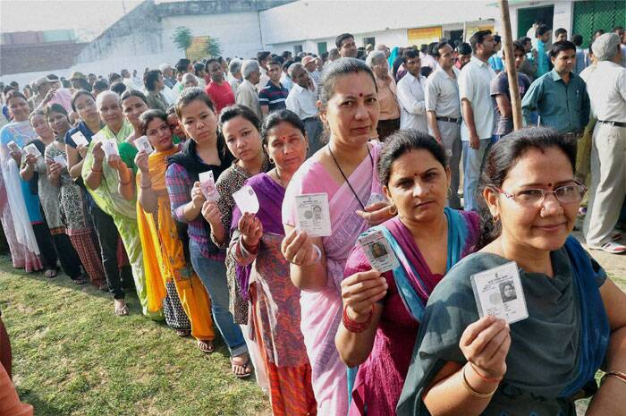 Voters stand in queue to cast their vote for Lok Sabha elections in Moradabad on Thursday. (PTI)
