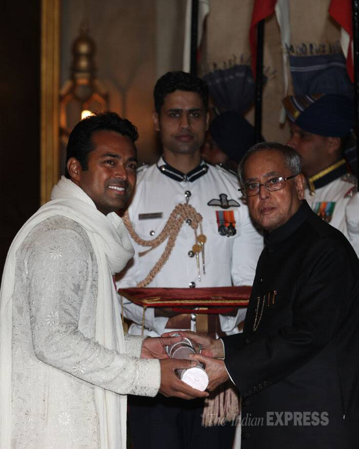 Tennis player Leander Paes is seen receiving his Padma Shri Award from President Pranab Mukherjee. (IE Photo: Renuka Puri)