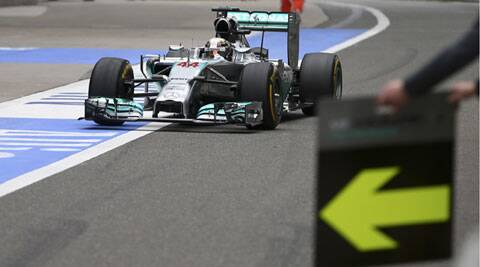 Mercedes Formula One driver Lewis Hamilton of Britain drives to a pit stop during the Chinese F1 Grand Prix in Shanghai. (Reuters)