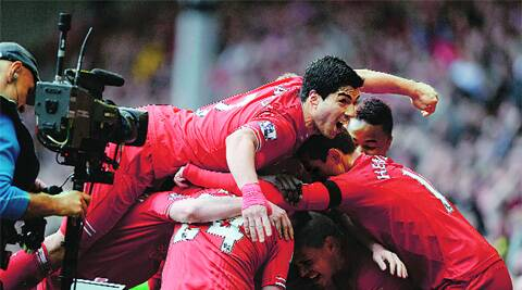 Red hot: Liverpool celebrate Philippe Coutinho's 78th-minute winner as they defeated Manchester City 3-2 to stay on course for a first league title in 24 years. They need to win their remaining four matches to lift their first Premier League title. (AP)
