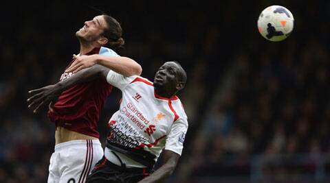 West Ham United's Andy Carroll (L) is challenged by Liverpool's Mamadou Sakho during their English Premier League match last Sunday. (Reuters)