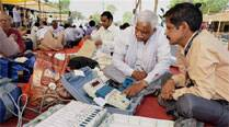 Poll officials check EVMs at a distribution centre at mandi on the eve of Lok Sabha elections in Agra on Wednesday. (PTI)