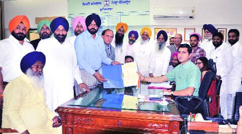 SAD candidate Manpreet Singh Ayali files papers at Mini Secretariat on Monday.  Gurmeet Singh