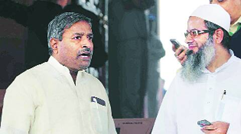 Madani with BJP leader Vinay Katiyar in a file photo. He was among the few clerics who had earlier supported  Modi when he refused to wear a skull cap. Archive