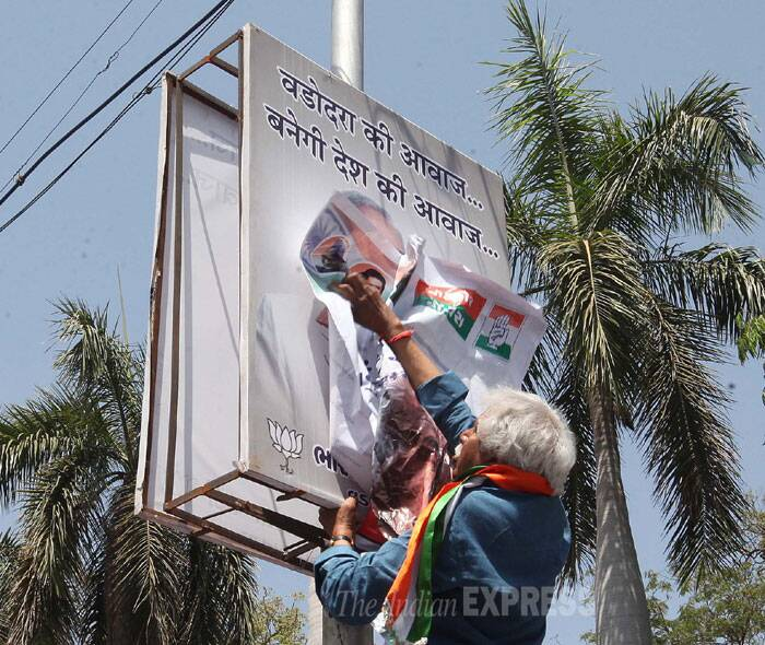 City police detained Congress candidate against Narendra Modi, Madhusudan Mistry, and other party workers when they tried to paste his posters on his rival's banners at advertisement kiosks in Dandiya Bazaar area in Vadodara. (IE Photo: Bhupendra Rana)