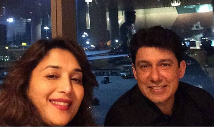 Bollywood' dancing queen Madhuri clicks another one along with hubby Sriram.
