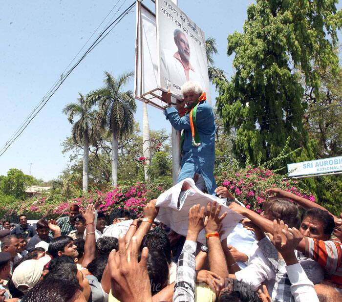 """Mistry and other Congress workers have been detained after they tried to paste his posters on a advertisement kiosk installed on electricity poll on road dividers,"" Vadodara DCP Dipankar Trivedi said. (IE Photo: Bhupendra Rana)"