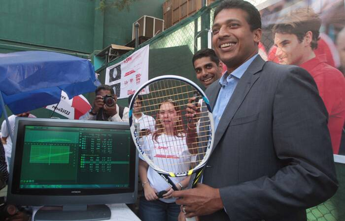 Mahesh Bhupathi poses with a steam racquet at the launch of the Spin Effect Tech rackets at CCI. (Express photo: Kevin DSouza)