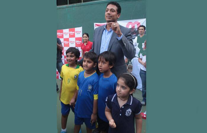 Lucky children getting clicked with their hero Mahesh Bhupathi. (Express photo: Kevin DSouza)