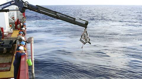 An autonomous underwater vehicle is deployed from ADV Ocean Shield in the search of the missing Malaysia Airlines Flight 370 in the southern Indian Ocean. (AP)