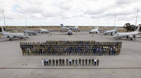 "Multinational air-crew and aircraft involved in operation ""Southern Indian Ocean"" are assembled for a photo at RAAF Base Pearce, in Perth, Western Australia. (AP)"