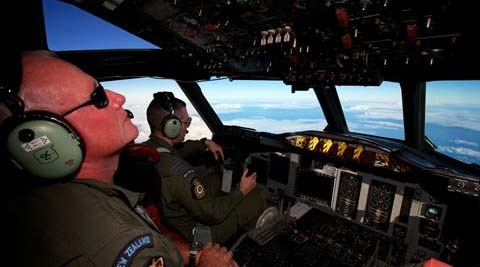 A Royal New Zealand Air Force P-3 Orion in the search for missing Malaysia Airlines Flight MH370 over the Indian Ocean on Friday. (AP)