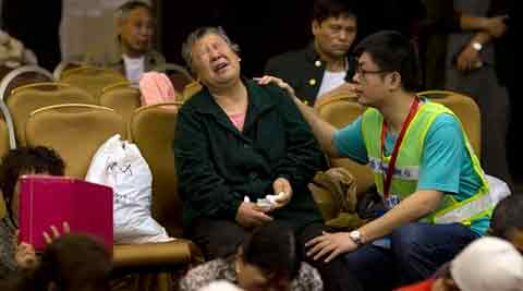 relatives of Chinese passengers onboard the Malaysia Airlines Flight 370 grieves at a hotel conference room in Beijing, China,