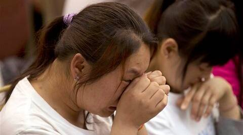 elatives of Chinese passengers onboard the Malaysia Airlines Flight 370, cry during a meeting in Beijing. (AP)