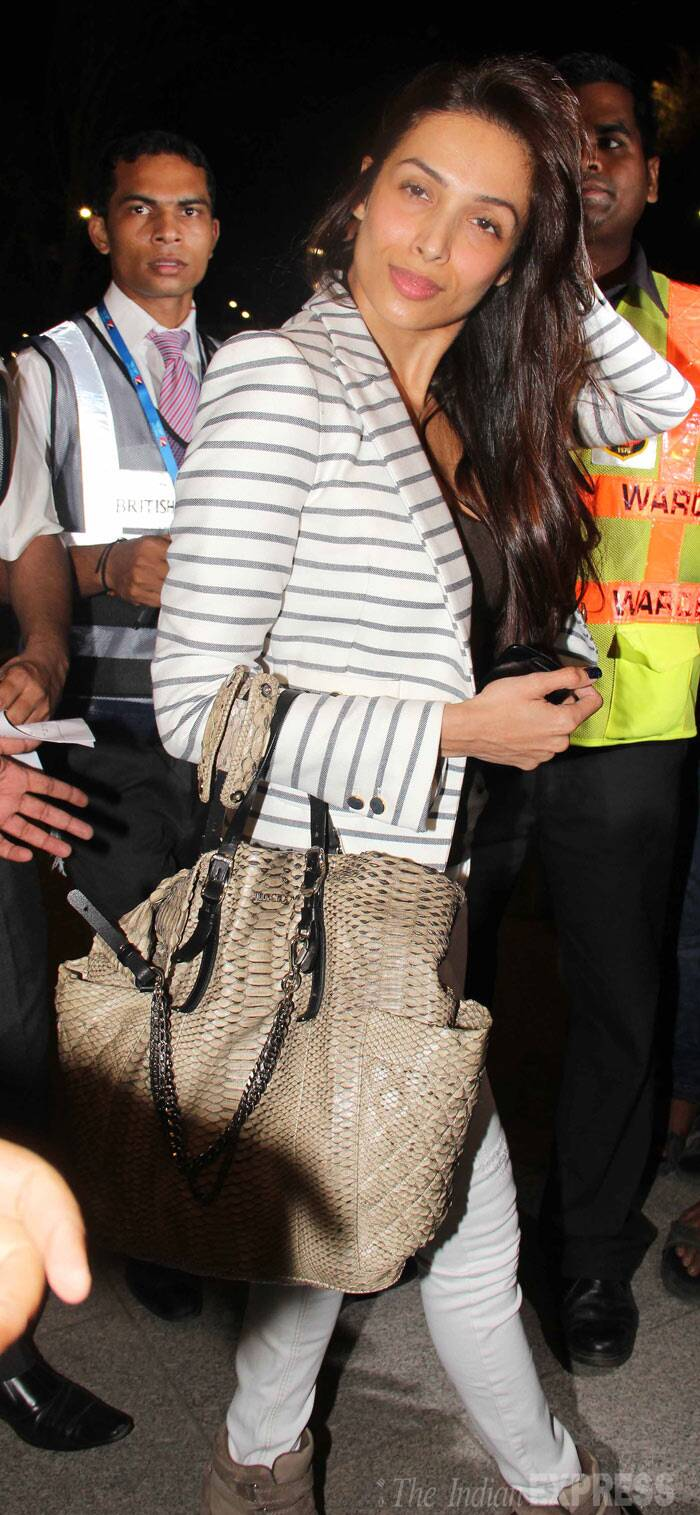 Malaika Arora Khan was sexy in a striped blazer and white denims, while she flaunted a Jimmy Choo Blare tote. (Photo: Varinder Chawla)