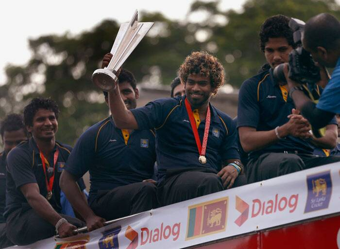 The triumphant Sri Lankan cricketers were today accorded a rousing reception by delirious fans as they touched down at Bandaranaike International Airport here after winning the World Twenty20 crown with the highlight being a victory parade on a decked-up double decker bus. (Reuters)