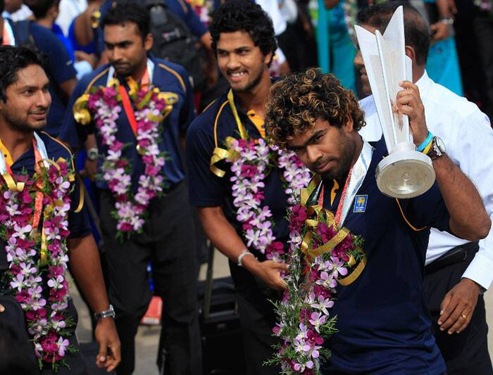 In one of the pictures, skipper Lasith Malinga was seen standing in front of the double decker bus and waving to the crowd. He was earlier seen holding the trophy  inside the plane. (Reuters)