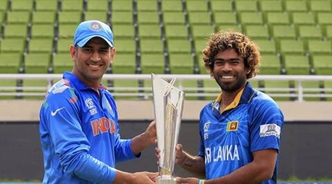 India's captain M.S Dhoni (L) and Sri Lanka's Lasith Malinga pose with the trophy of ICC Twenty20 World Cup on Saturday. (Reuters)