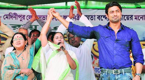 Chief Minister Mamata Banerjee campaigns for party candidates Sandhya Roy (L) and  Dev (R) in West Midnapore Monday. PTI