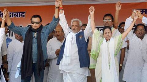 West Bengal CM and TMC chief Mamata Banerjee with party leader actor Mithun Chakrborty at an election rally in support of party candidate Chandrashekar Dubey at Mugma in Dhanbad on Saturday. (PTI)