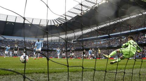 Manchester City's Yaya Toure (L) scores a penalty during their English Premier League match against Southampton on Saturday. (Reuters)