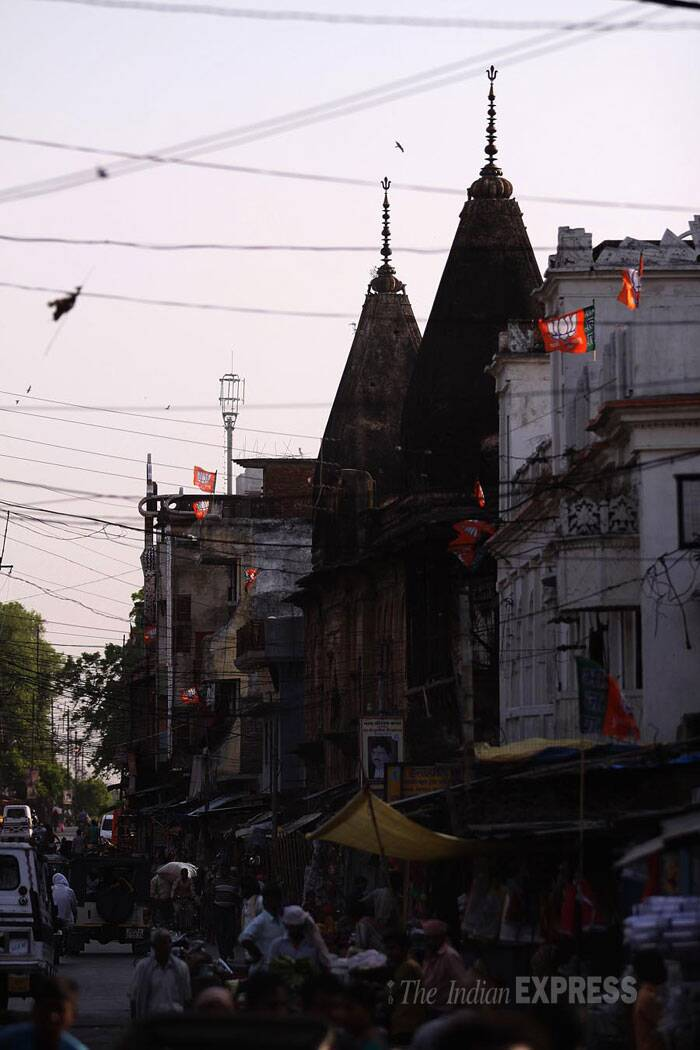 BJP party flag adorn most roof tops in Ayodhya. (IE Photo: Tashi Tobgyal)