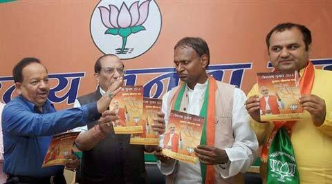 BJP leader Vijay Kumar Malhotra (2nd left) and candidates releasing the party manifesto for NCR in New Delhi on Wednesday. (PTI)