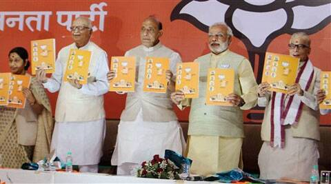 Bharatiya Janata Party's (BJP) Prime Ministerial candidate Narendra Modi (R), Party President Rajnath Singh (C) senior leader Lal Krishna Advani, Sushma Swaraj and MM Joshi release the party's election manifesto in New Delhi on Monday.  (PTI)