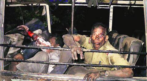 Injured policemen and polling officials at Sikaripara, in Dumka district on Thursday. PTI