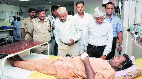 Former Jharkhand DGP V D Ram visits an injured personnel at a hospital in Ranchi on Friday. (PTI