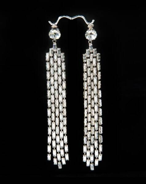 """This image provided courtesy of Julien's Auctions shows a pair of rhinestone earrings worn by Marilyn Monroe to a 1955 Hollywood film premiere, """"The Rose Tattoo."""" The earrings have sold at auction for $185,000. The sale was part of a two-day auction of Hollywood memorabilia April 11, 2014, and April 12, at Julien's Beverly Hills gallery in Los Angeles. (AP)"""