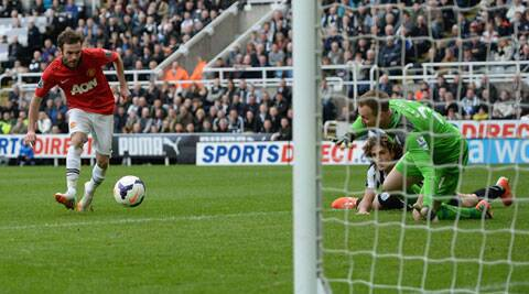 Manchester United's Juan Mata (L) shoots to score his second goal during their match against Newcastle United on Saturday. (Reuters)