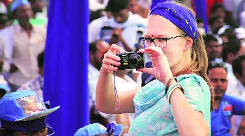 A foreigner takes photos at BSP chief Mayawati's rally in Allahabad on Sunday. PTI