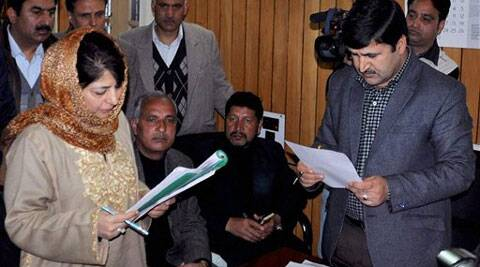 PDP President Mehbooba Mufti filling her nomination papers for Lok Sabha seat at District Development Commissioner's office in Anantnag district on Tuesday. (PTI)