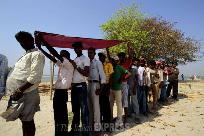 Villagers stand in a queue to cast their vote in Pataliputra constituency in Bihar on Thursday. (IE Photo: Ravi S Sahani)