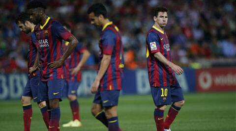 Barcelona's Lionel Messi reacts as he walks next to his teammates during their Spanish First Division football match against Granada on Saturday. (Reuters)