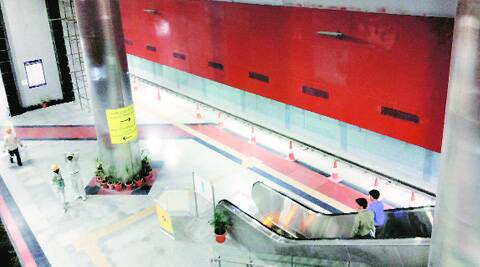 Workers give final touches to Janpath Metro station. (Praveen Khanna)