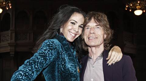 Mick Jagger has flown to L'Wren Scott's favourite holiday island to to help him come to terms with her death.
