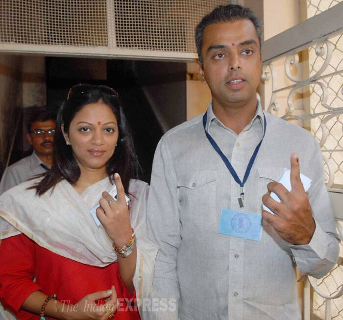 Congress MP Milind Deora cast his vote with wife Pooja Shetty Deora in Mumbai. (IE Photo: Vasant Prabhu)