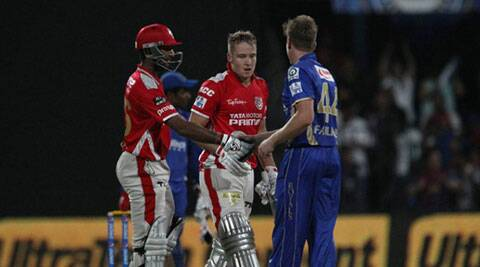 Cheteshwar Pujara (L) and David Miller (Centre) of Kings XI Punjab shake hands with Rajasthan Royals all-rounder James Faulkner after KXIP won the match with eight balls to spare. (BCCI/IPL)