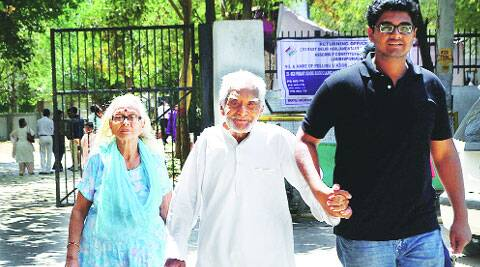 An elderly couple comes out of the polling station after casting their votes in Lajpat Nagar. (Dipantar Borah)