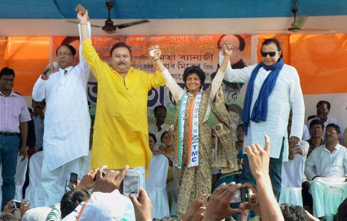 Bollywood actor and TMC MP Mithun Charaborty with party candidate Arpita Ghosh (L) and party leader Madan Mitra during an election campaign rally at Harirampur in South Dinajpur district of West Bengal on Thursday. (PTI)