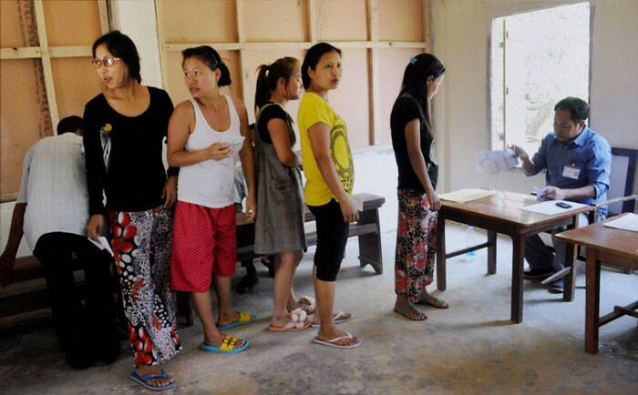 An electorate of 7,02,189, of whom 3,55,954 are women are eligible to cast votes in 1,126 polling stations.<br /> Voters wait in a queue to cast their votes for Lok Sabha polls in Aizawl. (PTI)