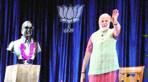 Narendra Modi addresses supporters through 3D video link in Allahabad on Monday. PTI