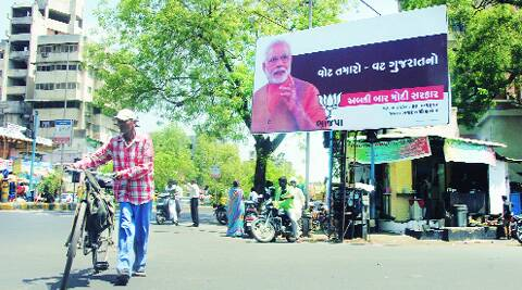 "Hoardings with picture of Narendra Modi stating that ""your vote is Gujarat's vote"" have come up across Ahmedabad and Gandhinagar. (Bhavesh Ravat)"