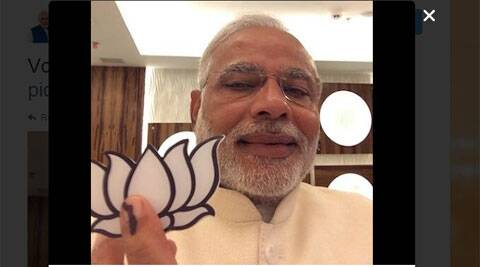 Narendra Modi snapped a selfie after casting his vote in Gandhinagar.