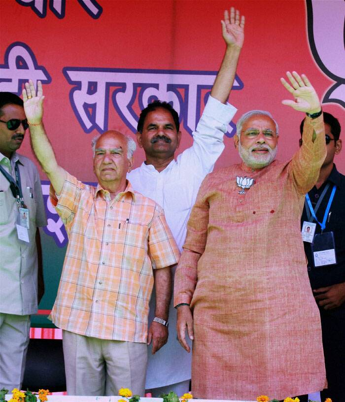 """I do not like saying it but Congress is a party that betrays people. It is a ""dhokebaaz"" party. See their 2009 manifesto. It is not a manifesto but a 'dhokapatra',"" he said at an election rally. <br /> BJP PM candidate Narendra Modi with party candidate from Kangra Shanta Kumar during an election rally in Palampur, Himachal Pradesh on Tuesday. (PTI)"