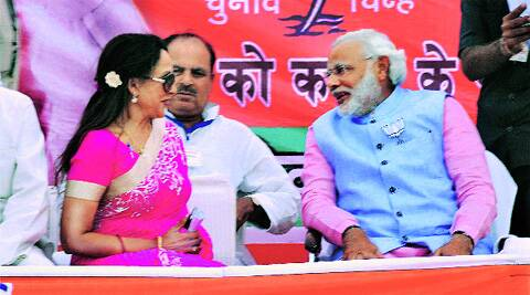 BJP candidate Hema Malini with Narendra Modi at a rally in Mathura on Monday.