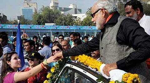 Gujarat Chief Minister Narendra Modi shakes hand with a foreign participant during International kite festival at Sabarmati River front in Ahmedabad . File photo/ PTI